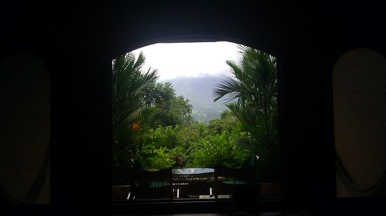 The Springs Resort and Spa :                                     Picture from bedroom looking at Arenal Volcano