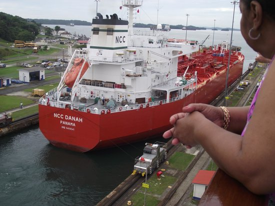 Panama Canal Partial Transit Tour:                   Another ship travelling through the canal in the adjacent lane.