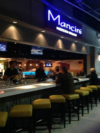 Mancini's:                   Outside looking into restaurant- open bar