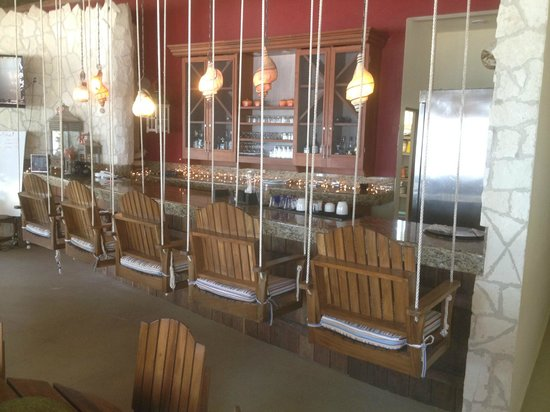 GrandSlam Fly Fishing Lodge:                   Swinging chairs at the bar