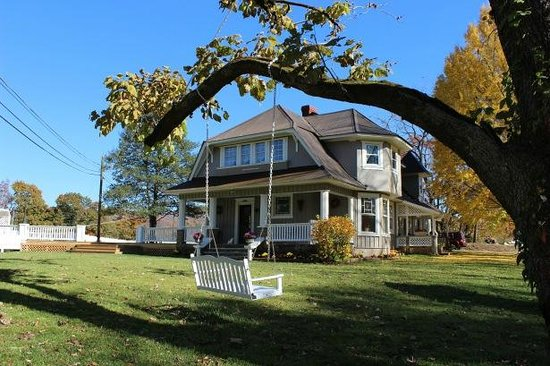 Millsap-Baker Estate: Manor House (1895), 3000 sq ft deck (added 2012, on left), and catalpa tree loveseat swing.