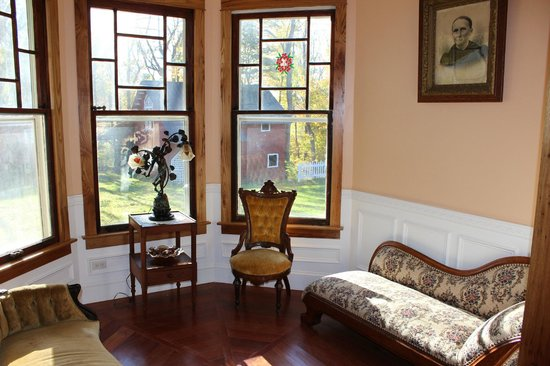 Millsap-Baker Estate: Sittng room, note antebellum faining couch and view of 1870s barn.