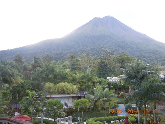 The Royal Corin Thermal Water Spa & Resort :                   View of Arenal volcano from balcony