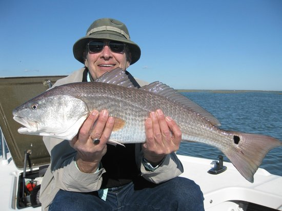 Fish Call Charters - Private Tours :                   Me with a redfish!