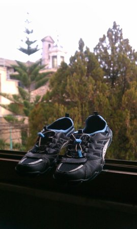 Hotel San Francesco:                   Nothing says vacation like drying your shoes in the window! (Love the church t