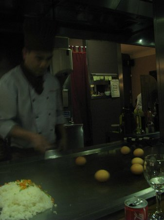 Tippenyaki:                   Chef getting eggs ready for cooking with the fried rice
