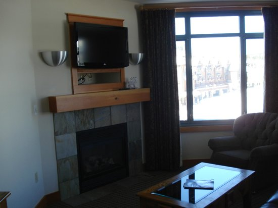 The Summit At Big Sky:                   TV/Fireplace in living room of 525