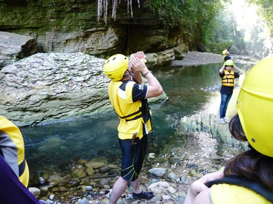 Atabey Eco Adventures :                   Using the Taino Fotuto to anounce our entrance to the Tanama river