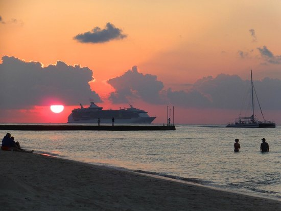 Melia Vacation Club Cozumel, All inclusive & Golf:                                     Sunset as the Royal Caribbean Sails