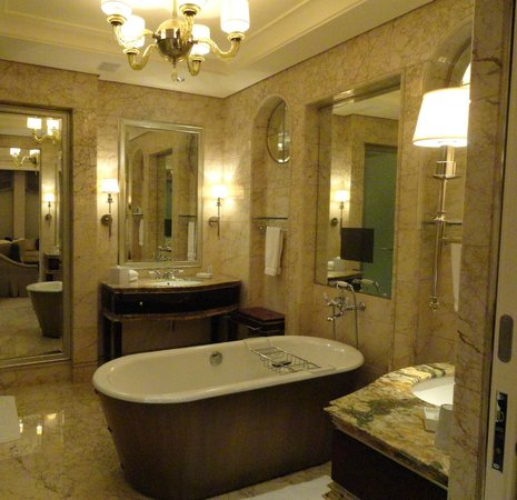The St. Regis Singapore:                   The gorgeous french marble bathroom with a tub and its own tv