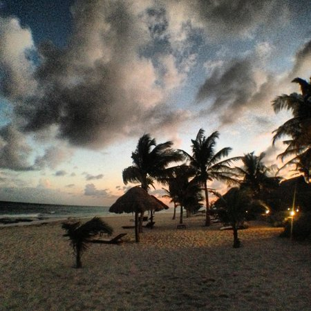 Le Reve Hotel & Spa:                                     Sunset out on the beach in front of the pool area.