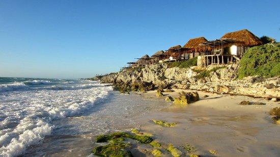 Azulik:                   The sun rises over these beautiful beach shacks.