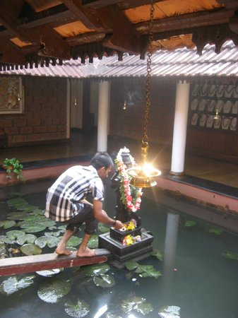 Punnamada Resort:                   Lighting the prayer lamps in the morning.