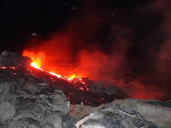 Kalapana Cultural Tours: Lava flowing into ocean