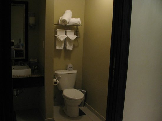 ذا مايو هوتل:                   Standing in kitchen area looking into bathroom.                 