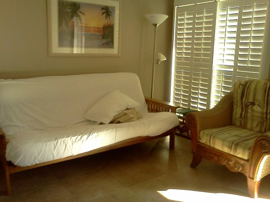 Tahitian Inn Hotel Cafe & Spa:                   Futon in living area of suite.
