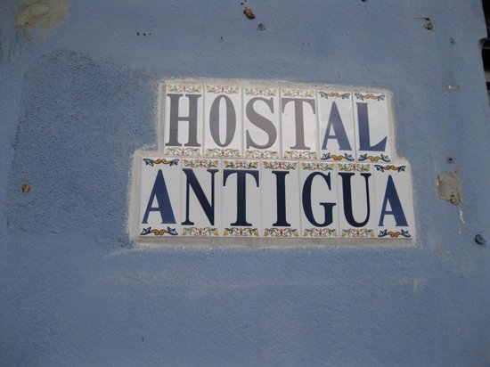 Hostal Antigua:                                     Sign on wall for hostel