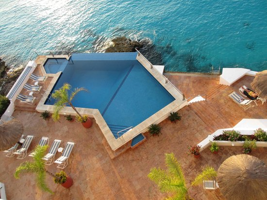 Puesta del Sol Condominiums:                   Lovely pool and patio area, ladder leads right into water