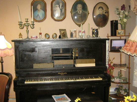 The Dormer House:                                     antique piano in palor