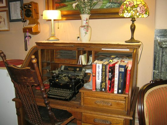 The Dormer House:                                     antique desk and typewriter in palor
