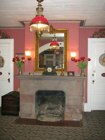 The Dormer House:                                     fireplace in lobby with two guest rooms on either side