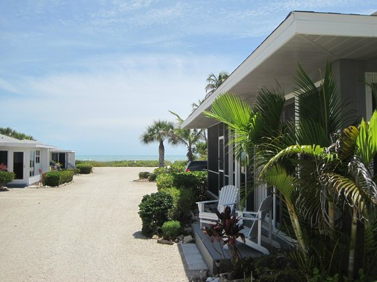 vacation island may cottages s sanibel rental on id beach sky tree contain plant outdoor bailey cottage image baileys home media grass house