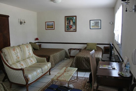 Logis La Breche:                   Large family room, outdated but spacious