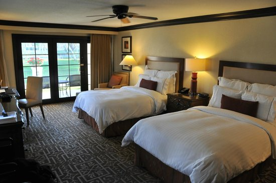 Omni Rancho Las Palmas Resort & Spa:                   Double room with walk-out patio.