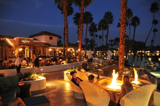 Omni Rancho Las Palmas Resort & Spa:                   Pool and restaurant at dusk.