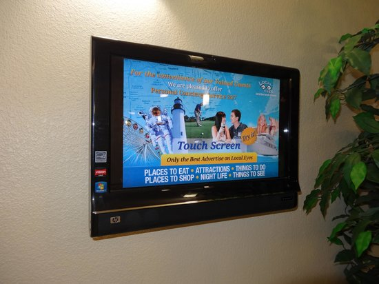 La Quinta Inn & Suites Houston / Clear Lake - NASA:                   At the reception desk is this touch screen t.v. for finding info. on local att