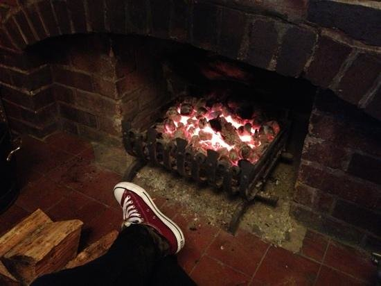 The Packhorse Inn:                   Warming my feet by the fire after a day walking in the Peak District.