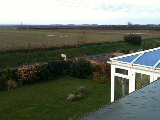 Kingsacre House B&B:                   View from Ocean Room out to the Saunton Sands sand dunes.
