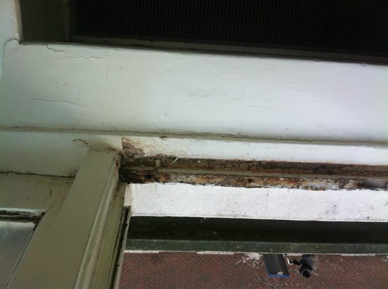 Trianon Hotel:                   Window rotting