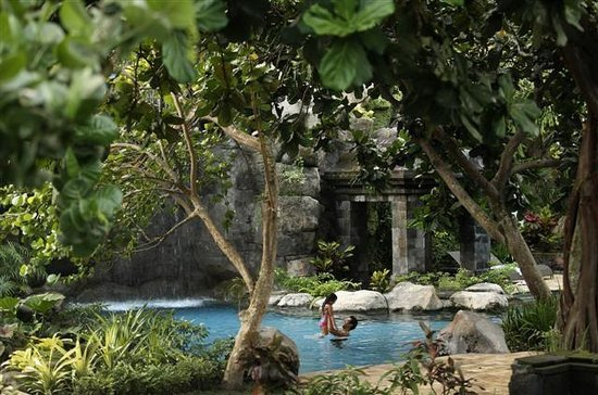 Ngaglik, Indonesia: Multi-level swimming pool with 70 meters waterslide surrounded by beautiful landscape