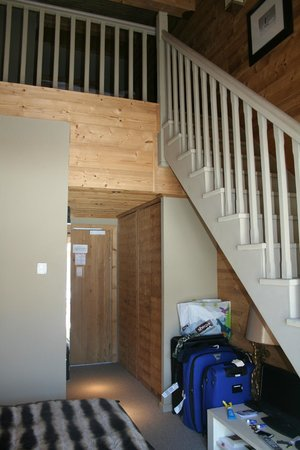 Hotel Le Chalet Blanc :                   Stairs to children's floor with bunk beds
