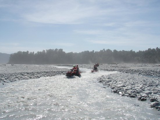 Across Country Quad Bikes:                   through the river we come..