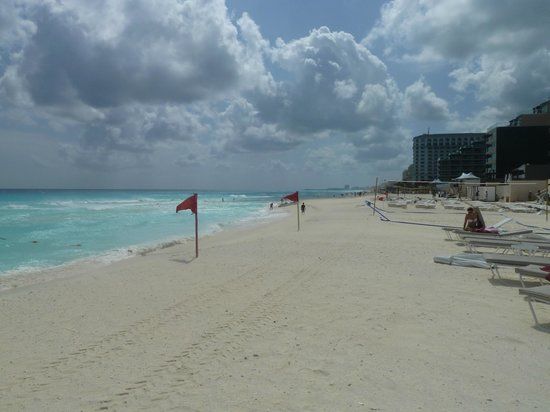 Sandos Cancun Luxury Resort:                   The beach - windy so red flag day (can swim but with caution)