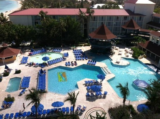 Breezes Resort & Spa Bahamas:                   VIEW OF THE POOL AREA FROM ROOM #825
