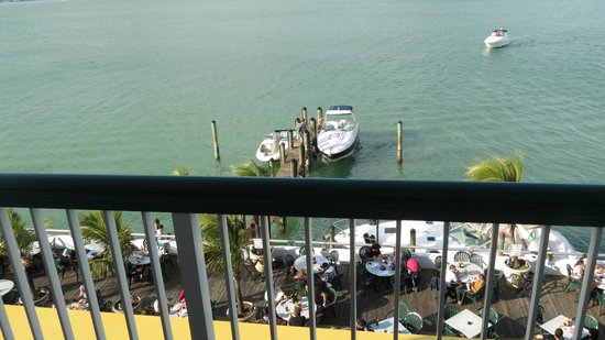 Shuckers Dockside Bar & Grill :                   Looking down at Shuckers from our balcony...