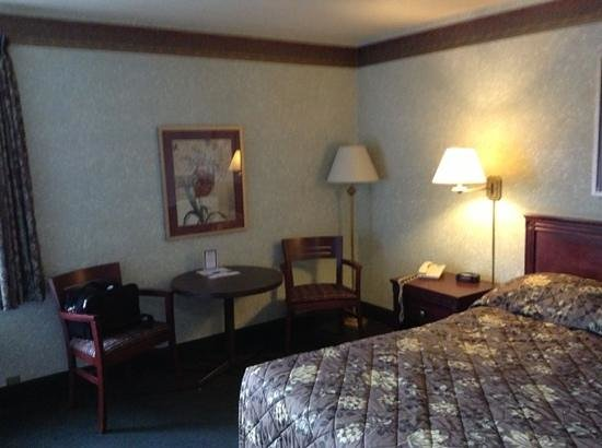 Canadas Best Value Inn Toronto:                   comes with a table and two chairs.