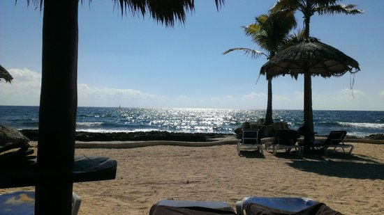 Dreams Puerto Aventuras Resort & Spa:                   Secluded beach area with natural pool