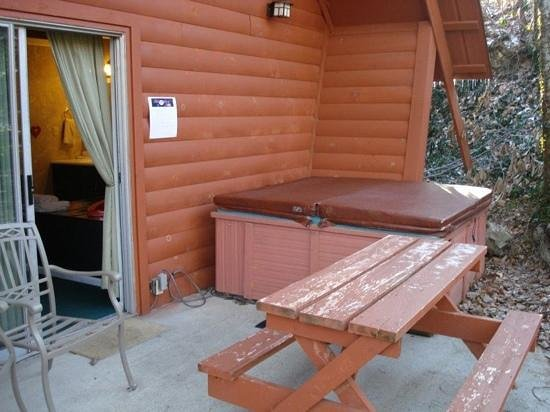 Honeymoon Hills Cabin Rentals:                   hot tub garden of Eden