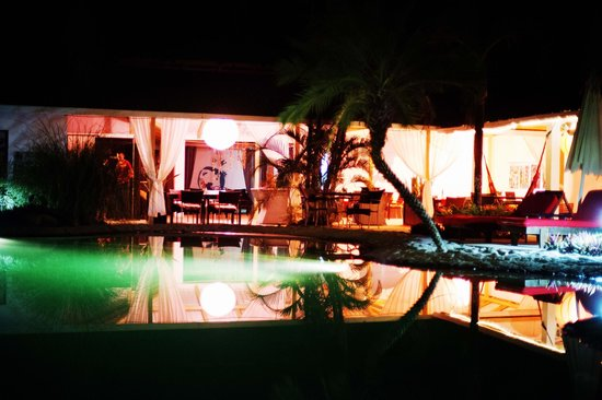 Hotel The Place:                   The pool by night