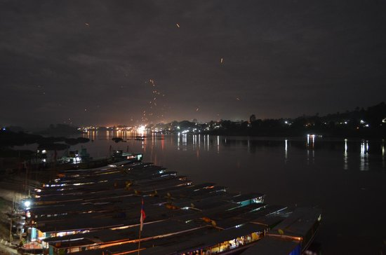 Riverside Houay Xai: View of Loi Krathong festival from outside our room