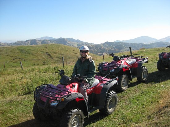 Glenstrae Farm 4 Wheel Adventures :                   Happiness is riding a 4 wheeler!