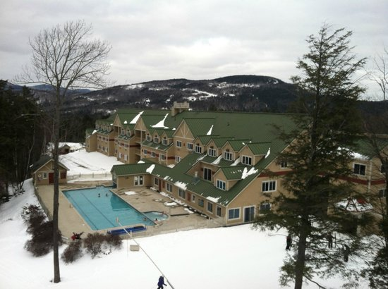 Grand Summit Resort at Sunday River :                   View of the hotel and pool from the lift along side it.