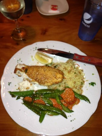 CJ's Beach House:                   Almond Crusted Halibut with seasonal vegetables and rice pilaf