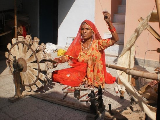 Wife of Sundar ji, spinning with her Charkha, from village