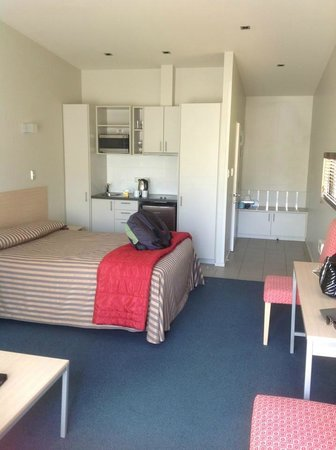 The Claremont Motel & Apartments:                   Kitchenette and bed in room