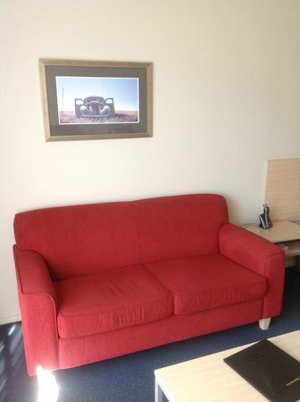 The Claremont Motel & Apartments:                   Seating area in room